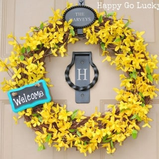 Spring Wreath with yellow flowers and chalkboard sign