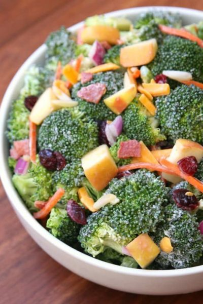 Broccoli, cranberries, carrots, apples, and cheese come together to make an amazing salad with delicious flavors and textures. The honey yogurt dressing on top makes this salad absolutely incredible! A delicious clean version of your favorite Broccoli Salad!