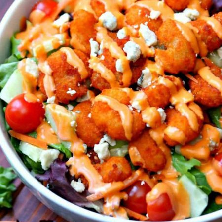 A delicious salad full of fresh vegetables and topped with buffalo shrimp. If you love all buffalo shrimp, you're going to love this Buffalo Shrimp Salad!