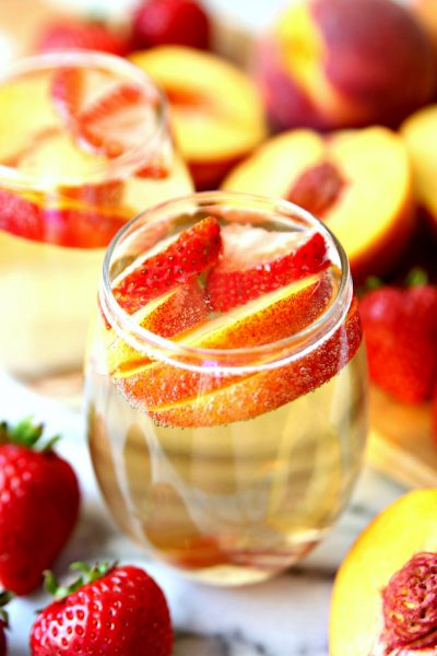 Peach Champagne Punch made with peach schnapps, champagne, and fresh peaches.