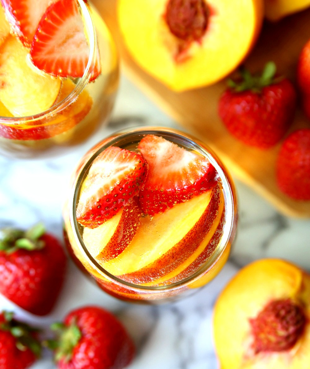 Peach Champagne Punch with peaches and strawberries
