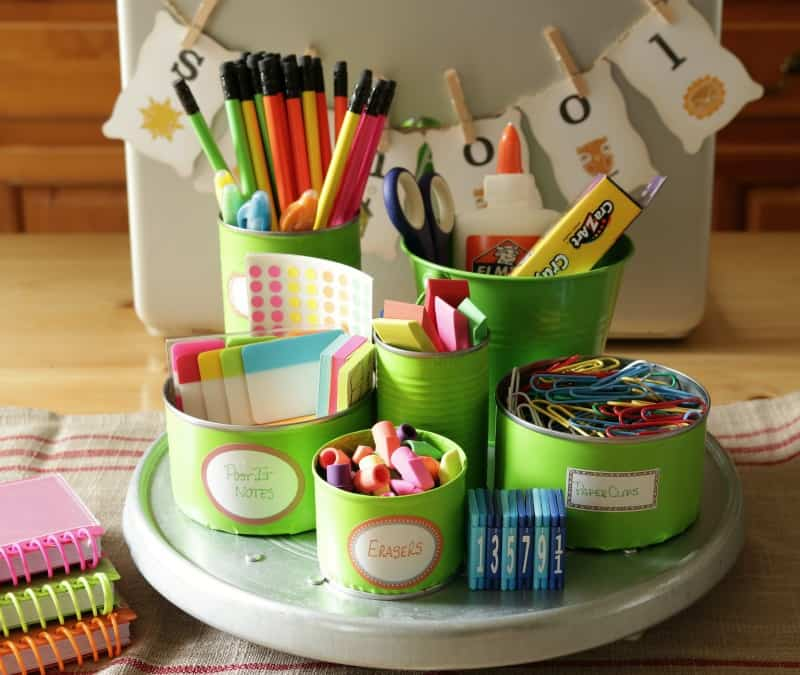 Save-your-tin-cans-and-use-them-to-organize-a-colorful-and-useful-back-to-school-homework-station.-1