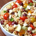 Sun Dried Tomato Pasta Salad in large bowl. The perfect summer side dish.