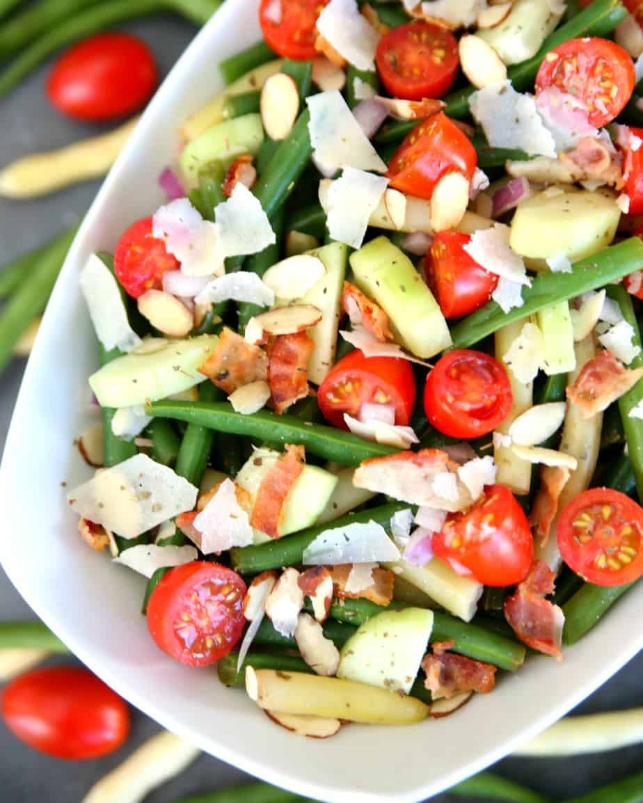 Bacon, Tomato, and Parmesan Bean Salad - A delicious and hearty salad full of fresh veggies and tossed in a delicious balsamic and olive oil dressing.  Top it with almonds and Parmesan cheese for a delicious salad everyone will love. #salad #saladrecipe #holidayrecipe #sidedish