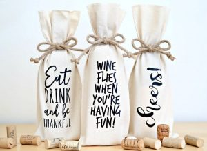 https://www.happygoluckyblog.com/wp-content/uploads/2018/01/Wine-Bottle-Gift-Bags-Horizontal-300x219.jpg