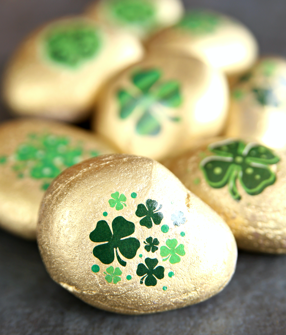 Lucky Kindness Rocks made with gold spray paint and temporary tattoes