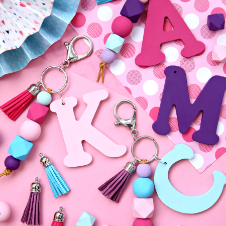 Initial Keychains made with wooden letters, wooden beads, and tassels