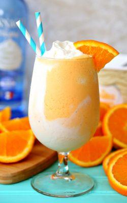 Boozy Orange Creamsicle Float recipe with orange soda, whipped cream vodka, and vanilla ice cream.