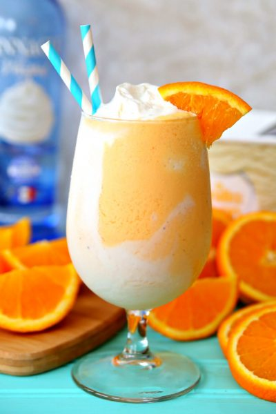 Boozy Orange Creamsicle Float recipe with orange soda, whipped cream vodka, and vanilla ice cream.