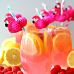 Pink Moscato Lemonade Recipe in wine glasses with lemons and raspberries