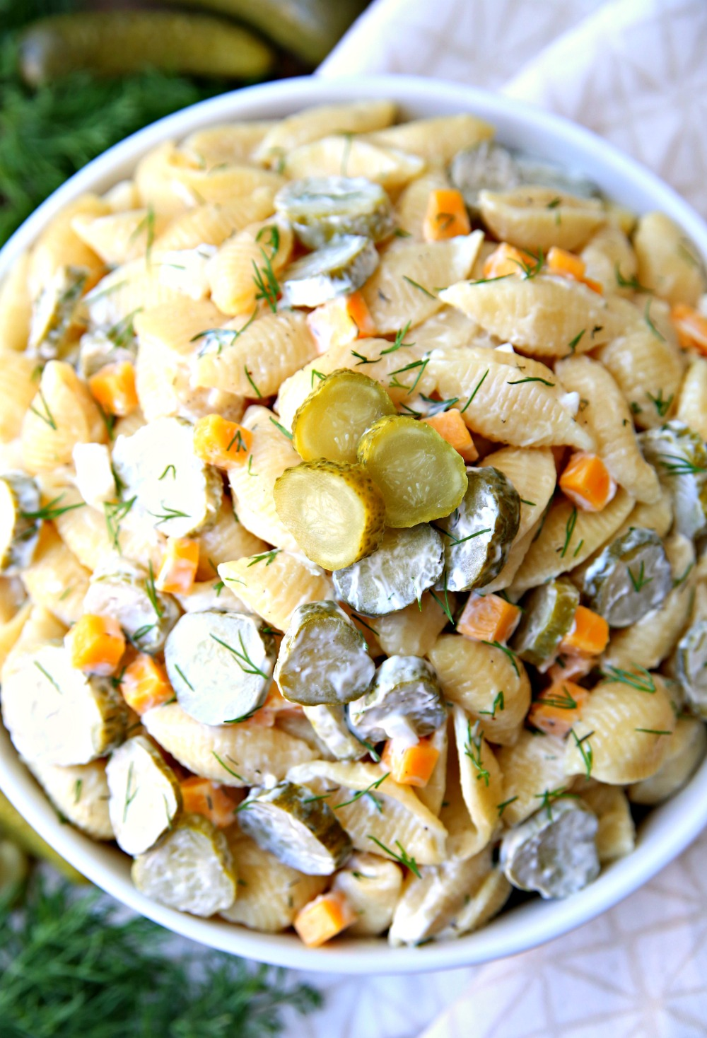 Dill Pickle Salad is a creamy pasta salad loaded with lots of dill pickles. The perfect pasta salad for parties.