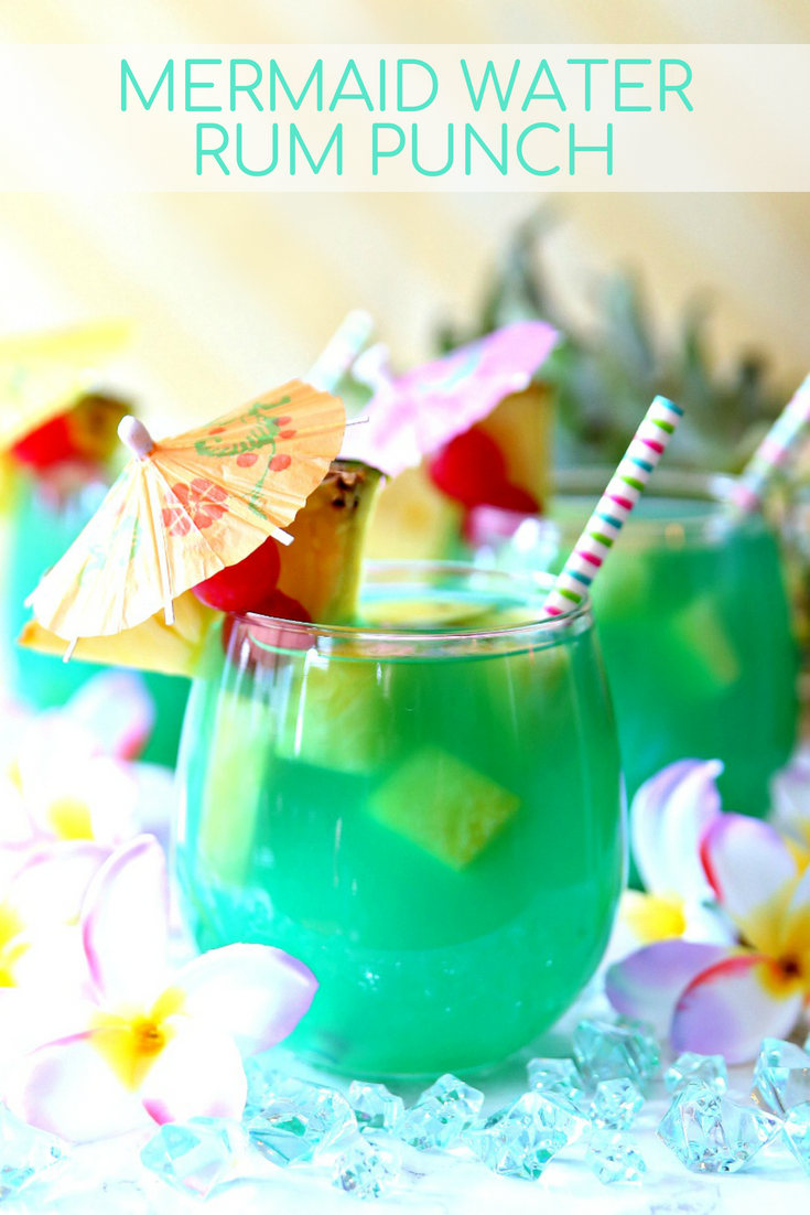 Relax this summer with a glass of Mermaid Water Rum Punch! A refreshing mermaid cocktail.  The perfect summer rum punch recipe!