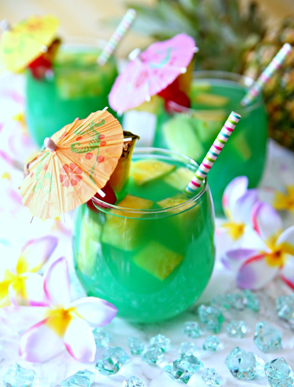 Relax this summer with a tall glass of Mermaid Water Rum Punch. A delicious coconut rum punch recipe!
