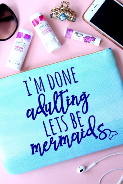 Use your Cricut to make this Mermaid Essentials Bag perfect for holding all your small items when headed to the beach and pool this summer.