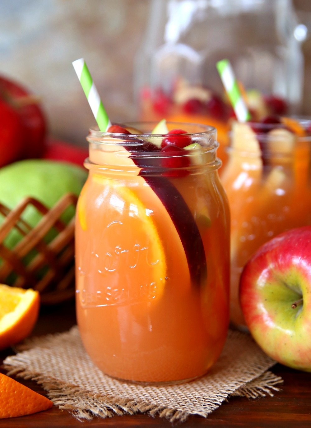 This Autumn Harvest Rum Punch has all the flavors of fall in one party punch recipe. The best fall cocktail for a crowd!