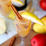Celebrate the cooler weather with these Spiced Pear Bellinis. A delicious cocktail full of pear juice, Prosecco and fall spices.