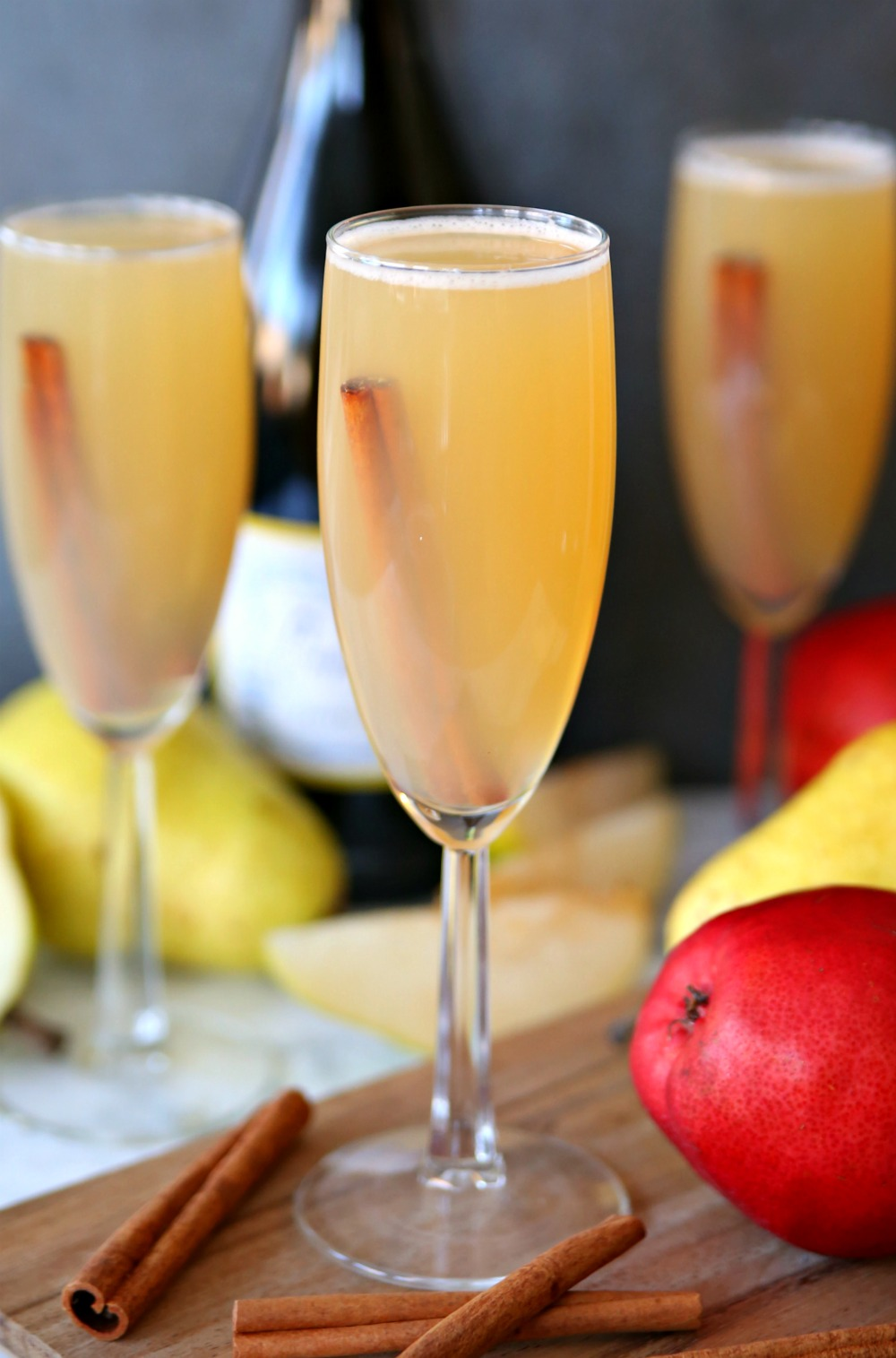 Celebrate the cooler weather with these Spiced Pear Bellinis. A delicious fall cocktail made with pear juice, Prosecco and fall spices.