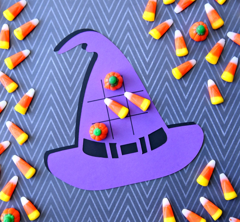 Want to play a game of tic-tac-toe this Halloween? Use your Cricut to make these festive Halloween Tic-Tac-Toe Boards. Don't forget the candy corn because they make the perfect game pieces.