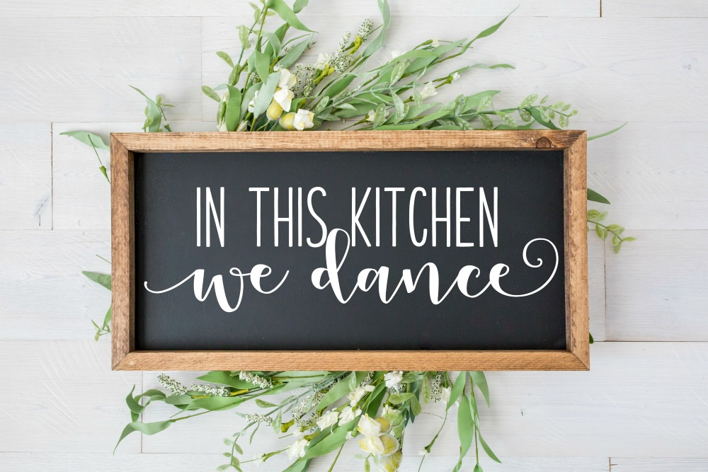 In this Kitchen We Dance wood sign created using the free SVG cut file