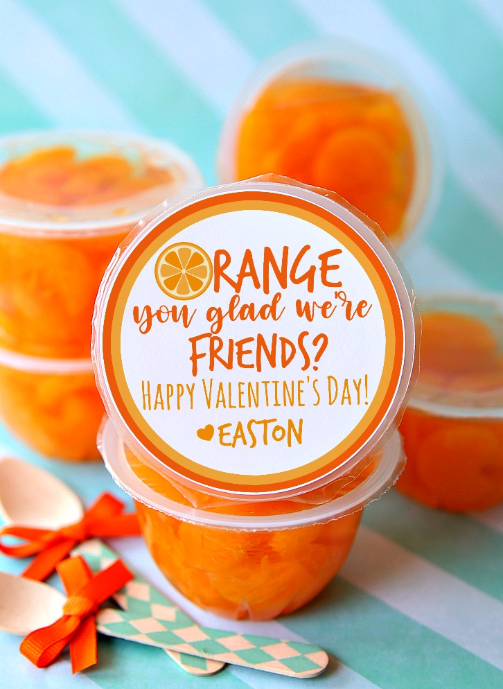 Orange You Glad We're Friends Valentine's Day tags added to cups of oranges. The perfect non-candy Valentines for kids.