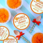 Orange You Glad We're Friends Valentine's Day Free Printable taped to mandarin orange cups