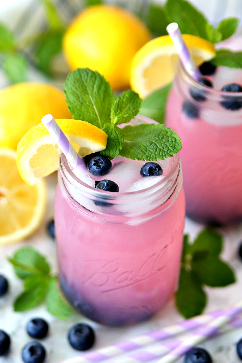 Blueberry vodka with pink lemonade served with frozen blueberries.