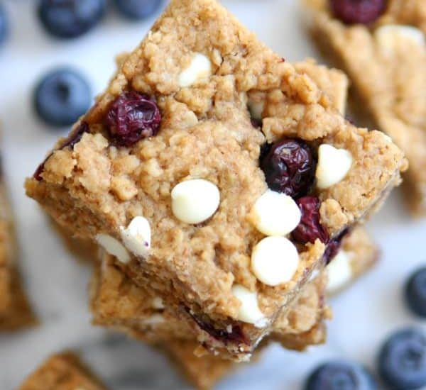 Blueberry White Chocolate Oatmeal Bars are the perfect summer dessert bursting with blueberries in every bite!