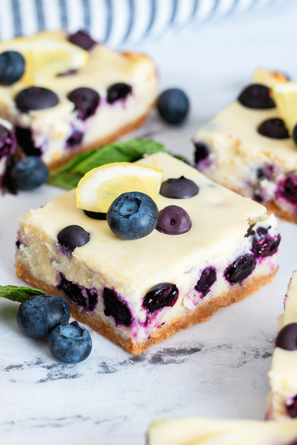 Blueberry Lemon Cheesecake Bars with blueberries and lemon slices