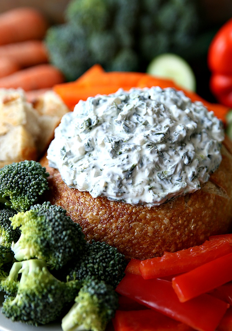 Ranch Spinach Dip in bread bowl with vegetables.