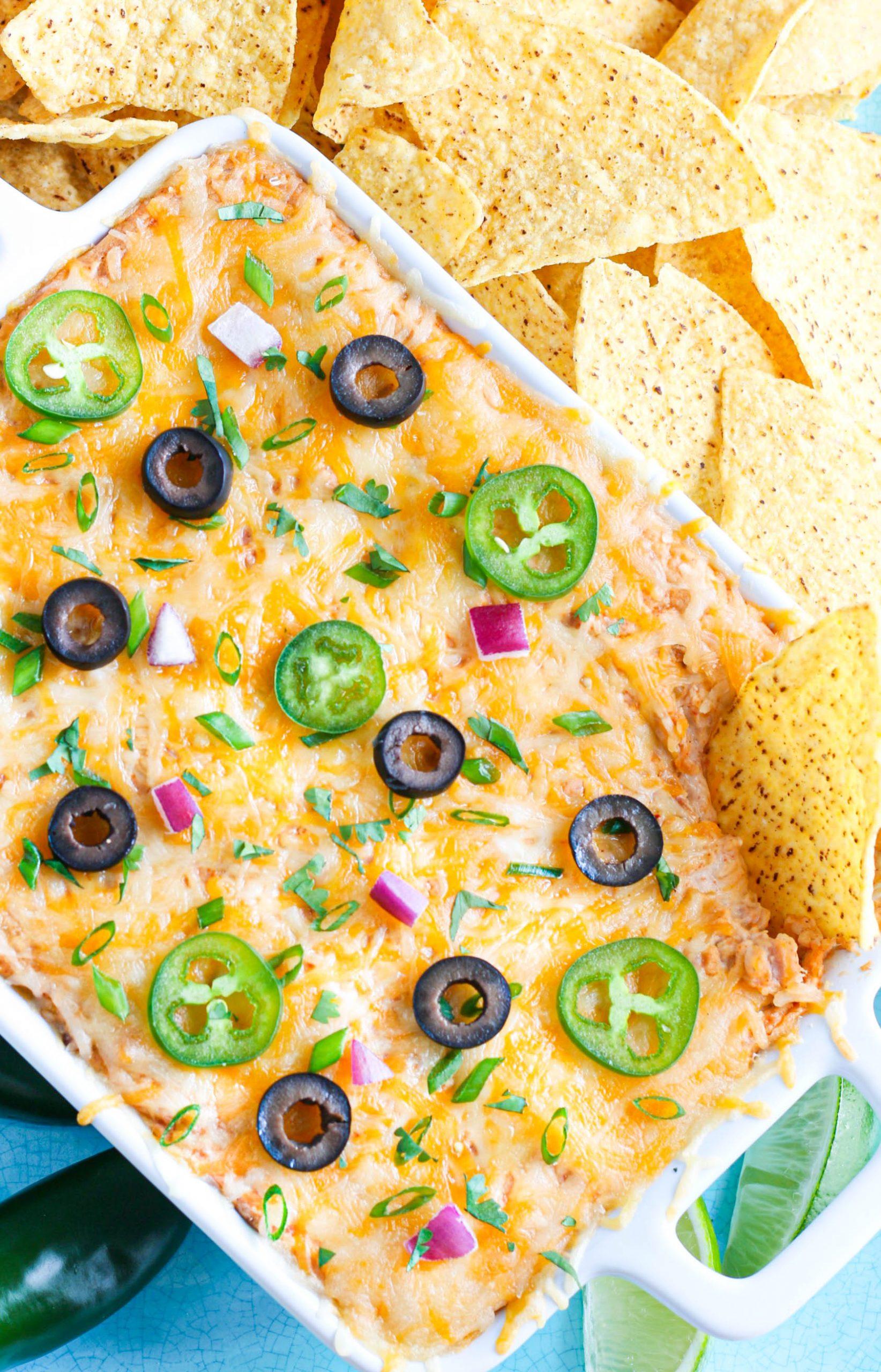 Bean Dip recipe with tortilla chips in white baking dish