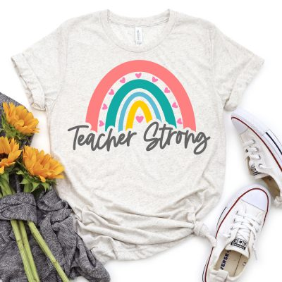 Rainbow Teacher Strong SVG on light gray shirt with sunflowers and tennis shoes.