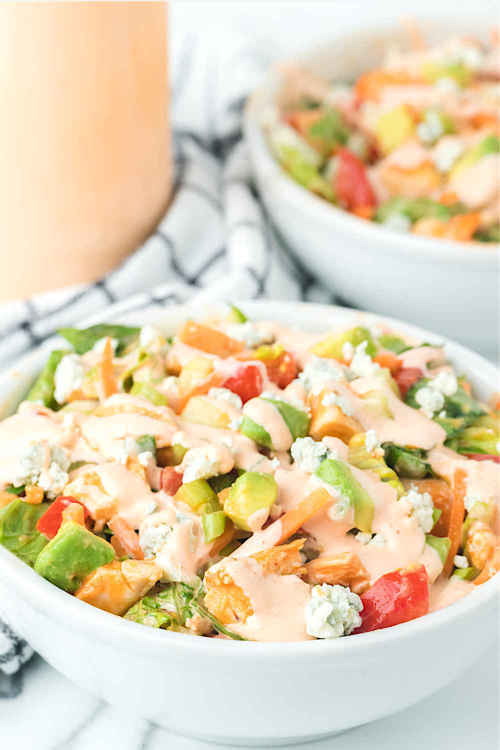 Buffalo Chicken Chopped Salad in white bowl with homemade buffalo ranch dressing