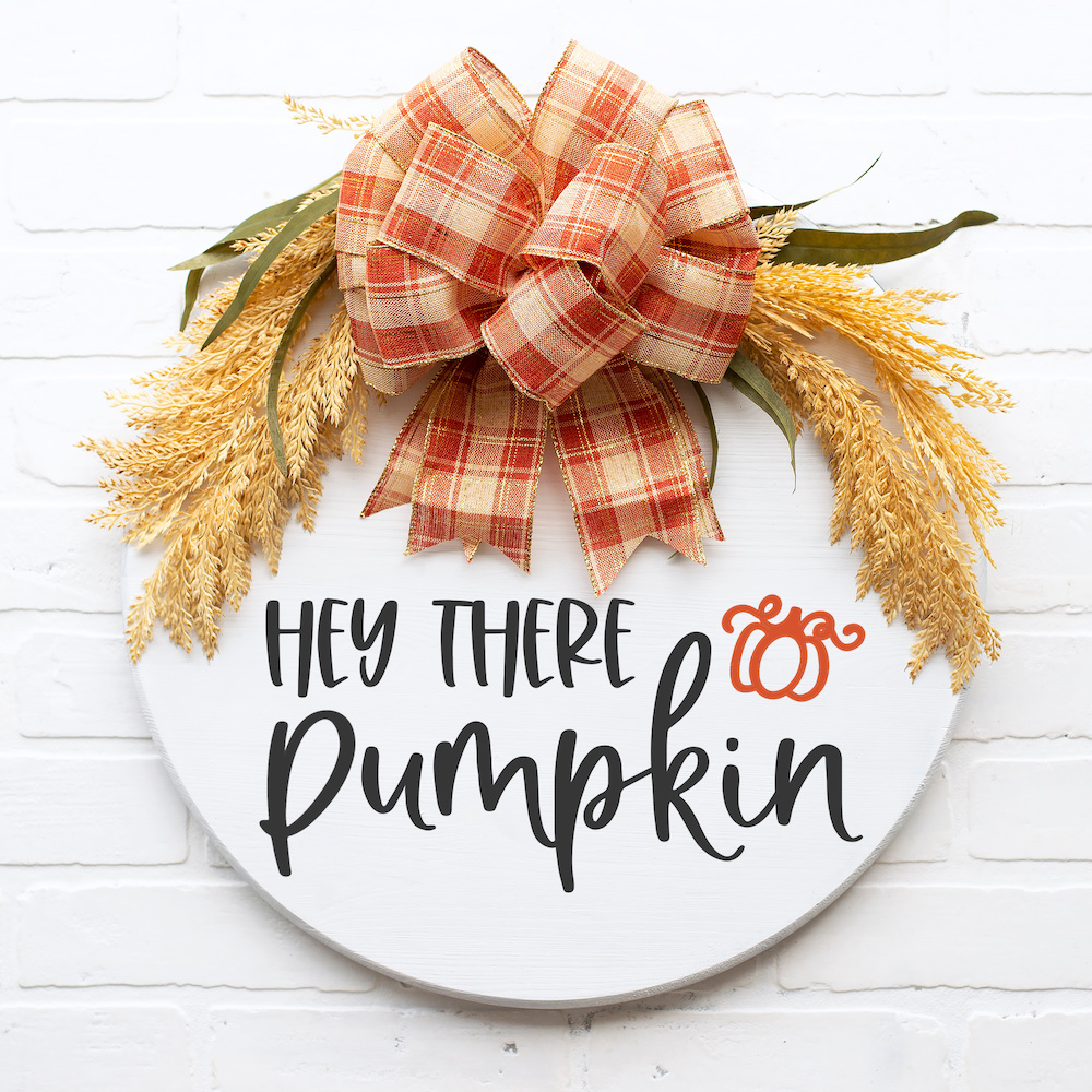 Hey There Pumpkin SVG on round white door sign