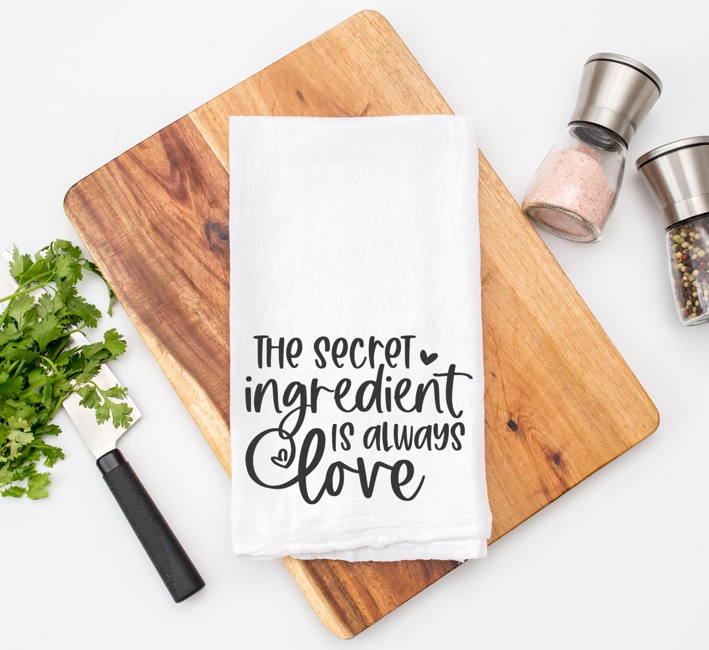 The Secret Ingredient is Always Love SVG Cut File on Kitchen Towel