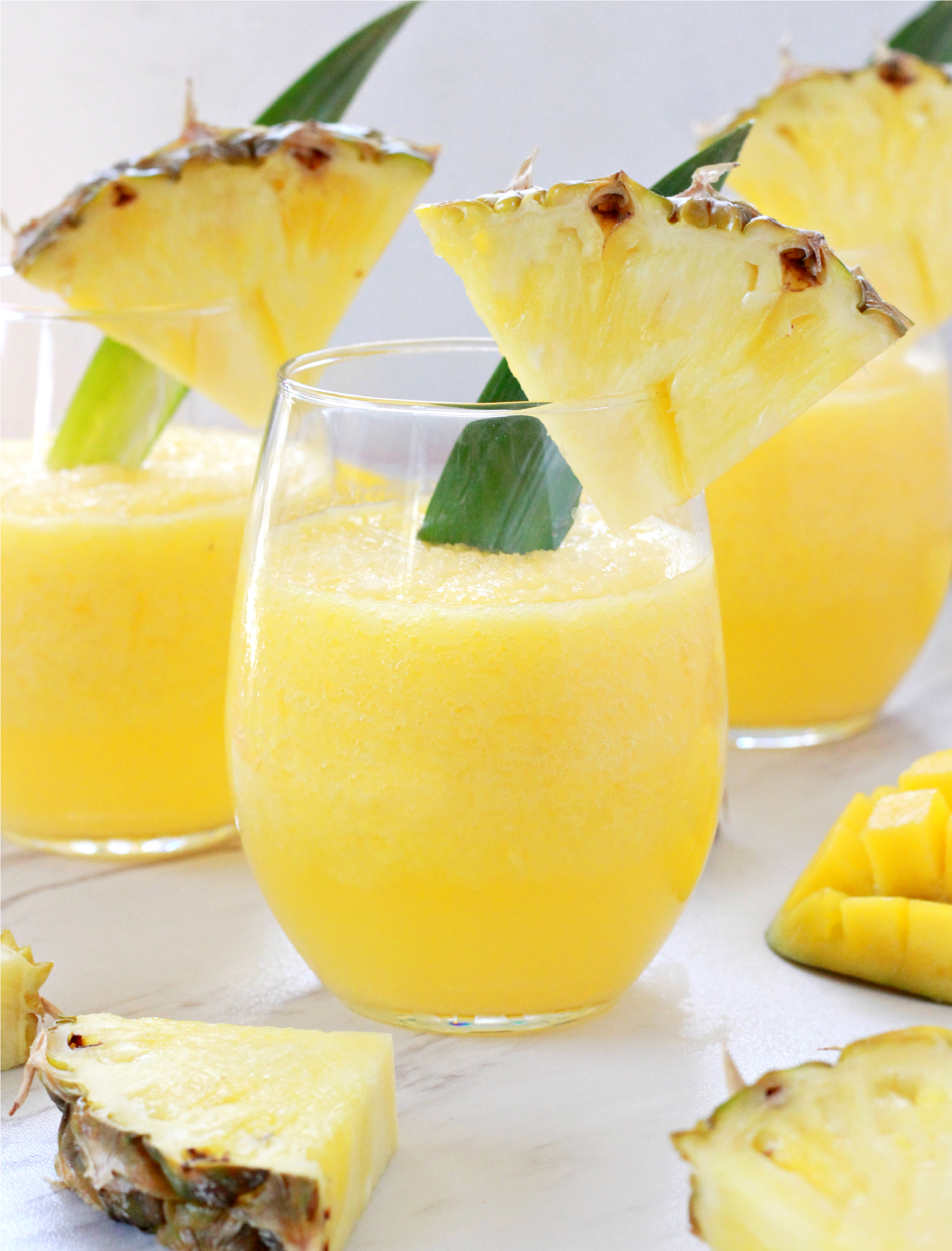 Tropicall Wine Slushies in wine glass with pineapples