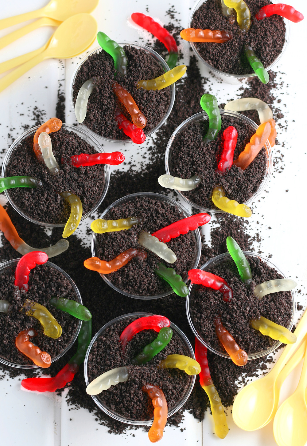Oreo Dirt Cups in clear cups with yellow spoons