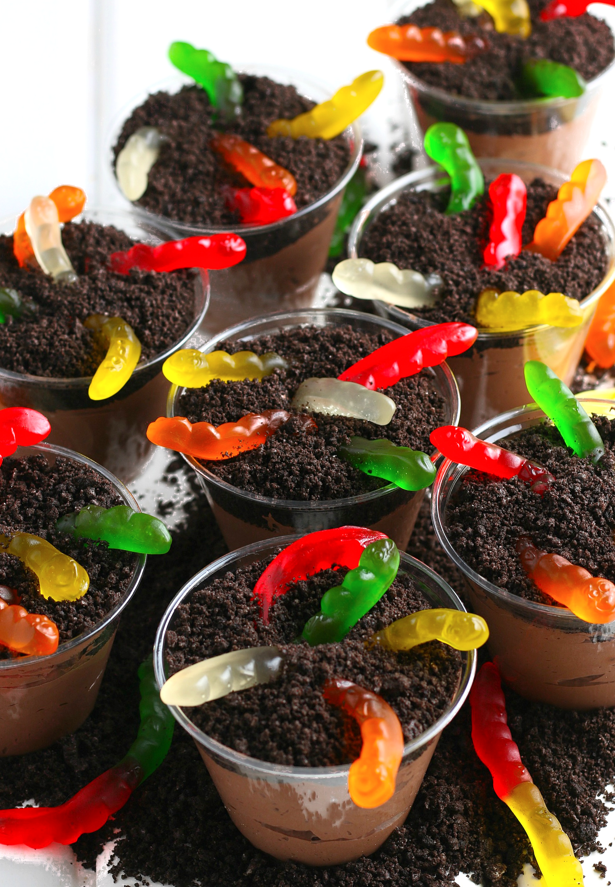 Oreo Dirt Cups with chocolate pudding, Oreos, and gummy worms.