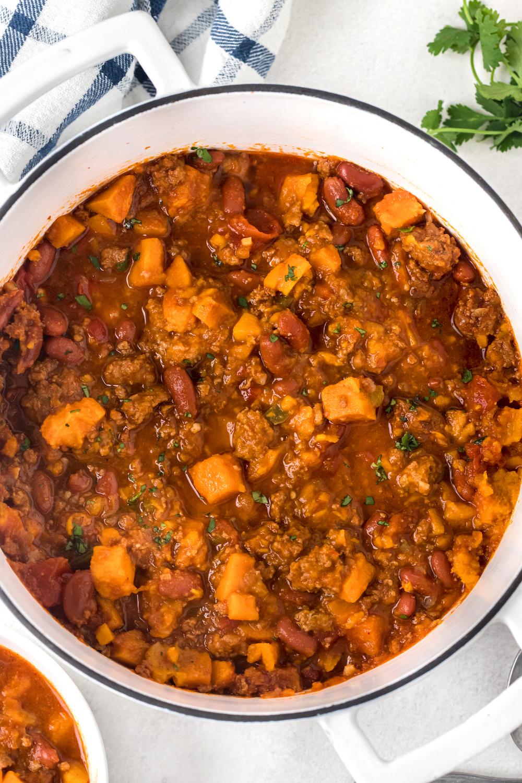 Homemade Chili in white pot